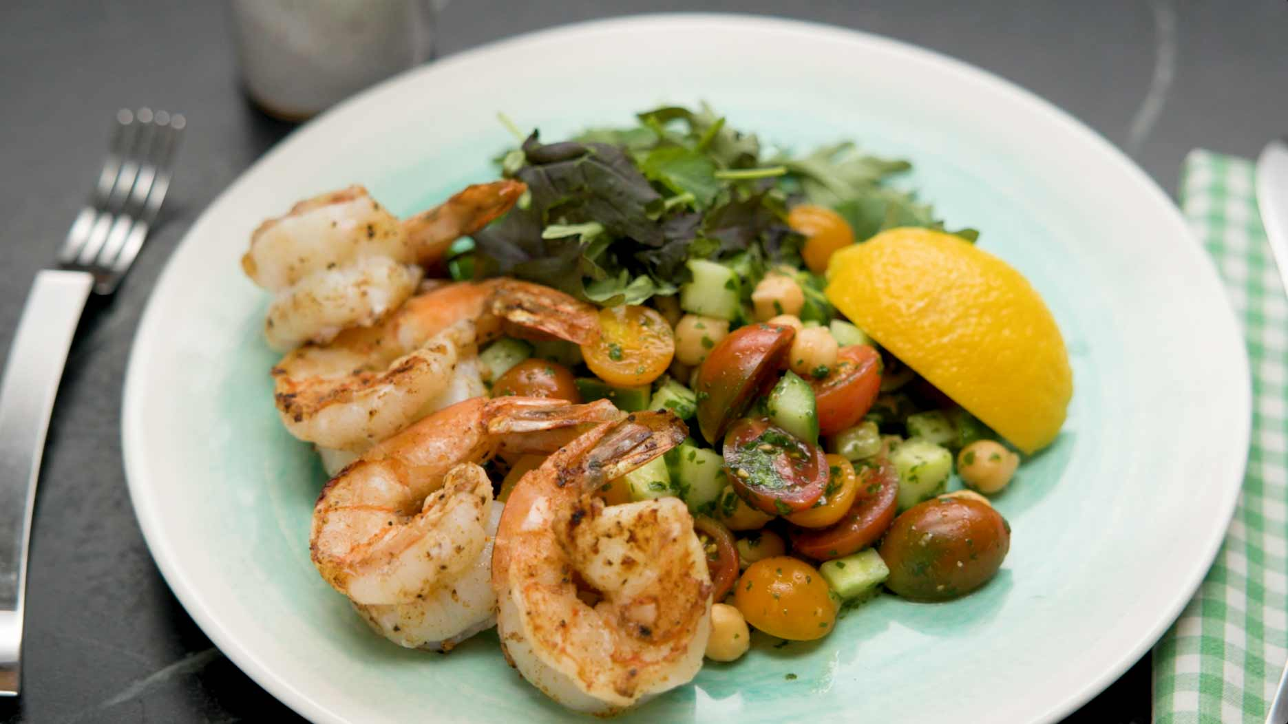 Ras el Hanout spiced shrimp with cucumber, tomato, chick pea salad